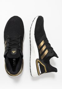 adidas Performance - ULTRABOOST 20 PRIMEKNIT RUNNING SHOES - Neutral running shoes - core black/gold metallic/solar red - 1