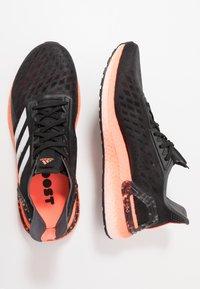 adidas Performance - ULTRABOOST - Zapatillas de running neutras - core black/footwear white/signal coral - 1