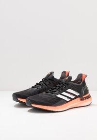 adidas Performance - ULTRABOOST - Zapatillas de running neutras - core black/footwear white/signal coral - 2