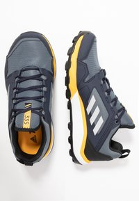 adidas Performance - TERREX AGRAVIC TRAIL RUNNING SHOES - Trail running shoes - onix/grey two/active gold - 1
