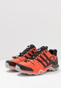 adidas Performance - TERREX SWIFT R2 - Zapatillas de senderismo - glow amber/core black/solar red - 2