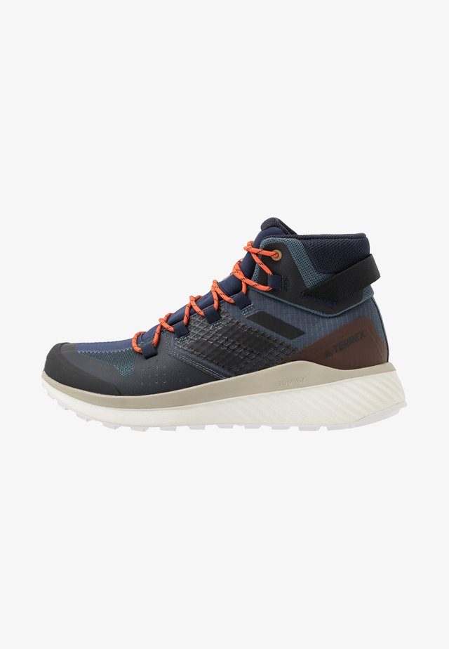 TERREX FOLGIAN HIKER MID GORE-TEX - Obuwie hikingowe - legend blue/core black/raw dessert
