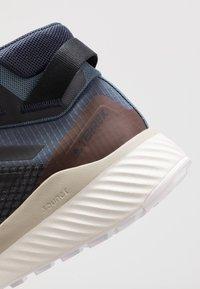 adidas Performance - TERREX FOLGIAN HIKER MID GORE-TEX - Hiking shoes - legend blue/core black/raw dessert - 5