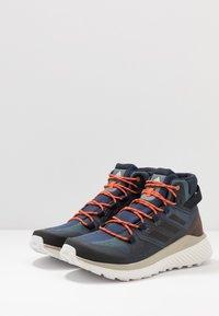 adidas Performance - TERREX FOLGIAN HIKER MID GORE-TEX - Hiking shoes - legend blue/core black/raw dessert - 2