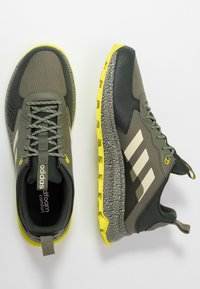 adidas Performance - RESPONSE - Zapatillas de trail running - legend green/sand/legend earth - 1