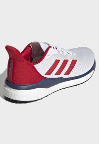 adidas Performance - SOLARDRIVE  SHOES - Zapatillas de running estables - white - 4