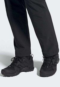 adidas Performance - TERREX AX3 HIKING SHOES - Hiking shoes - black - 0