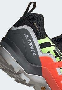 adidas Performance - TERREX SWIFT R2 GORE-TEX HIKING SHOES - Hiking shoes - black - 7