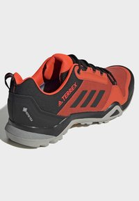 adidas Performance - TERREX AX3 GORE-TEX HIKING SHOES - Trail running shoes - red - 4
