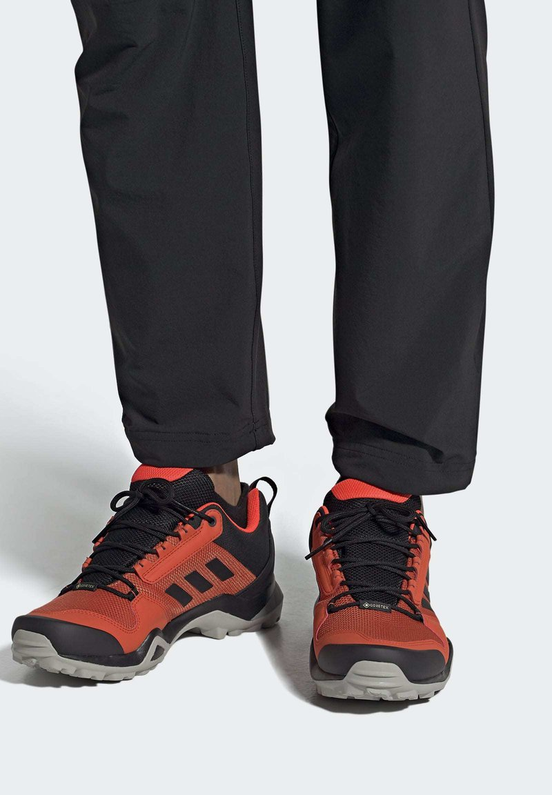 adidas Performance - TERREX AX3 GORE-TEX HIKING SHOES - Trail running shoes - red
