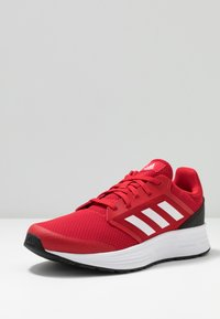 adidas Performance - GALAXY CLASSIC CLOUDFOAM SPORTS RUNNING SHOES - Obuwie do biegania treningowe - scarlet/footwear white/core black - 2