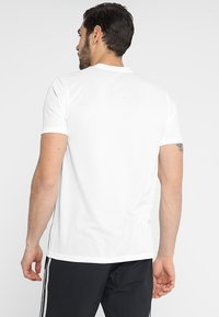 adidas Performance - CORE 18 - T-shirt z nadrukiem - white/black - 2