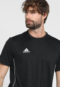 adidas Performance - CORE 18 - T-shirt print - black/white