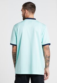 adidas Performance - TAN - Camiseta estampada - clear mint - 2