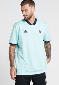 adidas Performance - TAN - Camiseta estampada - clear mint - 0