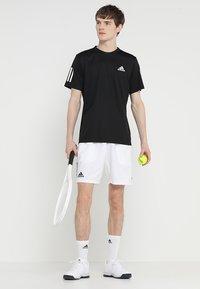 adidas Performance - CLUB TEE - T-shirt med print - black/white - 1