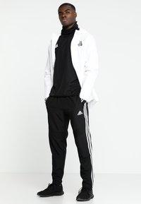 adidas Performance - TIRO19 WARM TOP - Long sleeved top - black/white - 1
