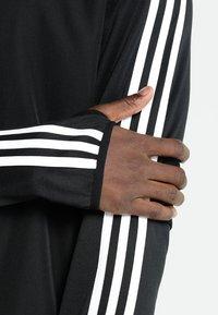 adidas Performance - TIRO19 WARM TOP - Long sleeved top - black/white - 5