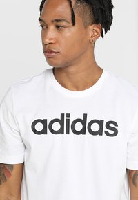 adidas Performance - LIN TEE - T-shirt con stampa - white/black - 4