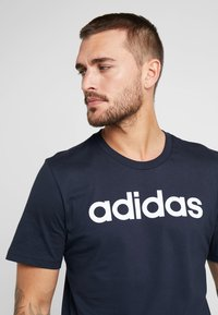adidas Performance - LIN - T-shirt med print - ink/white - 4