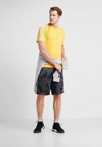 adidas Performance - T-shirt print - yellow - 1