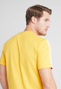 adidas Performance - T-shirt print - yellow - 5