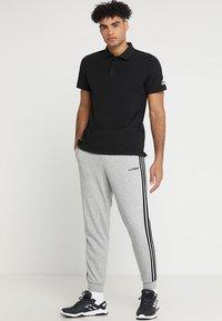 adidas Performance - PLAIN - Poloshirts - black - 1
