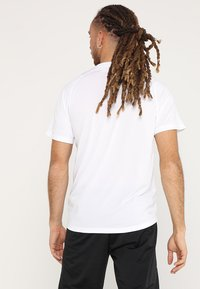 adidas Performance - T-shirt med print - white - 2
