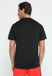 adidas Performance - T-shirt med print - black - 2