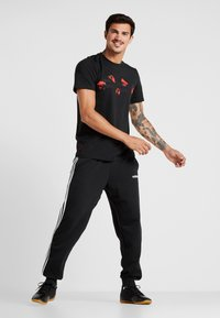 adidas Performance - MANCHESTER UNITED FC TEE - Fanartikel - black - 1