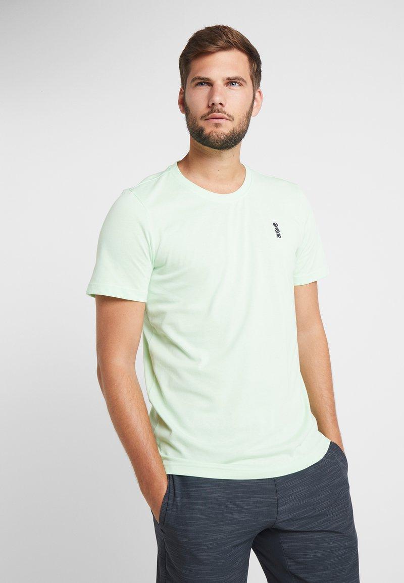 adidas Performance - GRAPHIC TEE - T-Shirt print - green