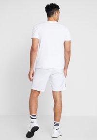 adidas Performance - CAT LOGO TEE  - Camiseta estampada - white - 2