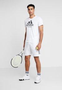 adidas Performance - CAT LOGO TEE  - Camiseta estampada - white - 1