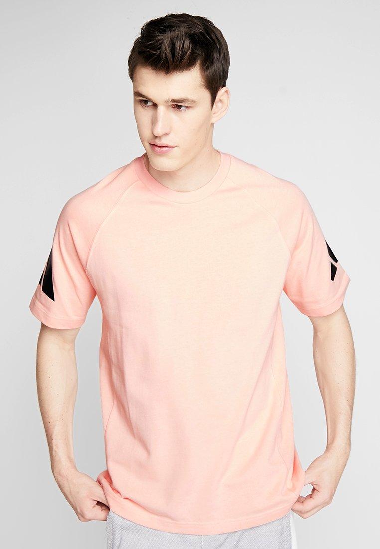 adidas Performance - HEAVY TEE - Camiseta estampada - glow pink
