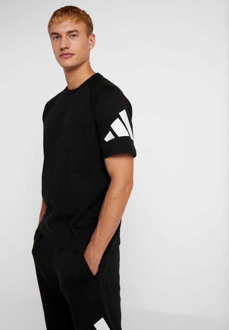 adidas Performance - HEAVY TEE - T-shirts print - black