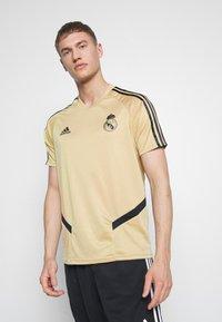 adidas Performance - REAL MADRID TR JSY - Squadra - gold/black - 0