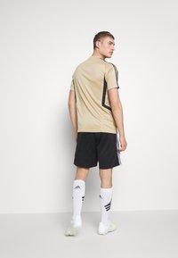 adidas Performance - REAL MADRID TR JSY - Squadra - gold/black - 2