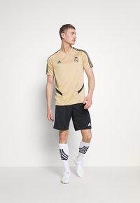 adidas Performance - REAL MADRID TR JSY - Squadra - gold/black - 1