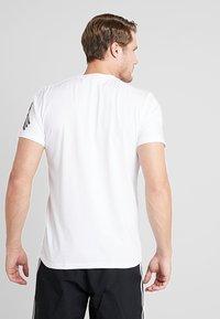 adidas Performance - TAN LOGO TEE - Camiseta estampada - white - 2