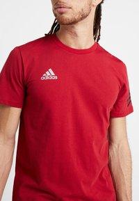 adidas Performance - TAN LOGO TEE - Camiseta estampada - active maroon - 5
