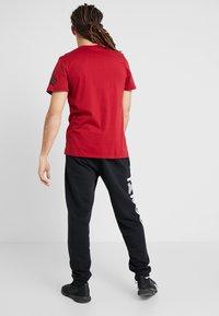 adidas Performance - TAN LOGO TEE - Camiseta estampada - active maroon - 2