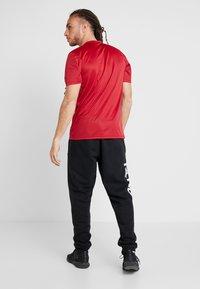 adidas Performance - TAN  - T-shirt print - active maroon - 2