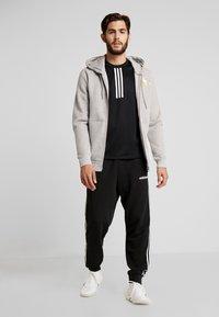adidas Performance - WARM CREW - Sportshirt - black - 1