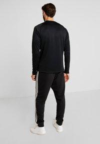adidas Performance - WARM CREW - Sportshirt - black - 2
