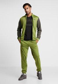 adidas Performance - VRCT T-SHIRT - Camiseta estampada - black - 1