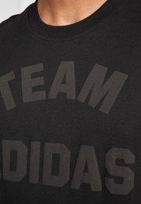 adidas Performance - VRCT T-SHIRT - Camiseta estampada - black - 5