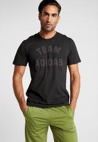 adidas Performance - VRCT T-SHIRT - Camiseta estampada - black - 0