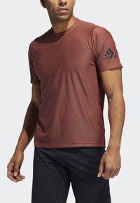 adidas Performance - FREELIFT T-SHIRT - T-shirt print - orange - 3