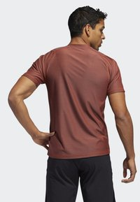 adidas Performance - FREELIFT T-SHIRT - T-shirt print - orange - 1