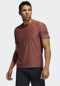 adidas Performance - FREELIFT T-SHIRT - T-shirt print - orange - 0